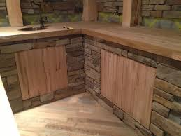 truck bed flooring planks were used to create this counter top and cabinet doors