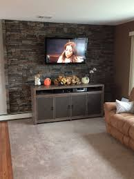 Living room accent wall made with Norwich Stacked Stone panels in Motley  Gray.