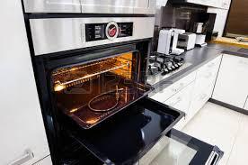 open oven in kitchen. modern hi-tek kitchen, oven with door open photo in kitchen
