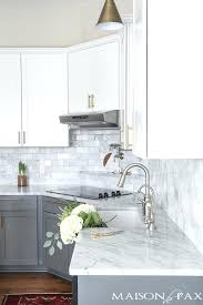 white kitchen gray countertops two toned gray and white cabinets marble subway tile a modern white kitchen grey countertop