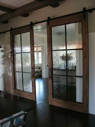 office entrance doors. Industrial Chic Barn Style Sliding Doors With Rippled Glass Panes Allow Privacy But Still Light To Filter Through. (Double Love-barn AND Office Entrance