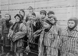 barbed wire fence holocaust. Simple Holocaust Child Survivors Of Auschwitz Wearing Adultsize Prisoner Jackets Stand  Behind A Barbed Wire Fence Inside Barbed Wire Fence Holocaust C