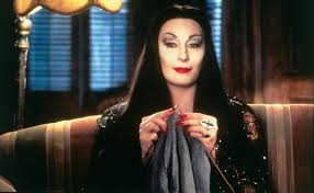 in the addams family morticia addams yn jones anjelica huston is the matriarch of the macabre addams family wife to gomez and mother to