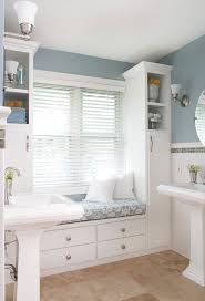 pedestal sinks with storage and window seat built