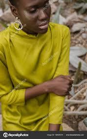 fashionable african american woman glitter makeup posing yellow dress stock photo