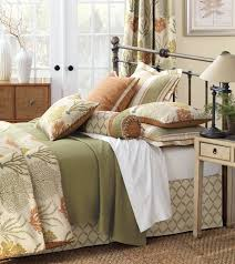eastern accents with wooden flooring and small standing lamp for bedroom design