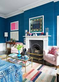 eclectic blue living room traditional english zebra print couch sofa grasscloth wallpaper covering room