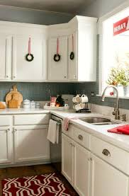 Kitchen decorating ideas Farmhouse View In Gallery Mini Wreaths On White Cabinets Trendir 23 Ways To Decorate Your Kitchen For The Holidays