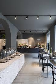 moody grey walls and warm white track lighting creates a beautiful ambiance in the potafiori flower milan by castelli costruzioni
