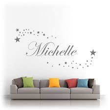personalised name in a script font surrounded by stars vinyl wall art matt finish on stars vinyl wall art with personalised name script font stars vinyl wall art sticker decal