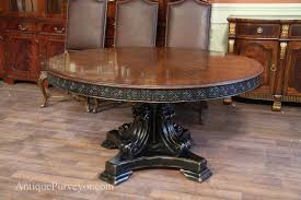 antique reion 60 inch round walnut finished table with black and gold accents