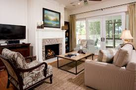 brick fireplace living room transitional with brick fireplace surround wood trim wood flooring