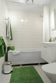 charming white tile bathroom with bathtub shower combo and shower curtain and floating vanity