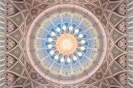 look up the impressive chandelier of sultan qaboos grand mosque