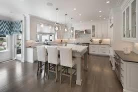 gray kitchen island with white parsons bar stools