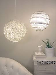 a duo of chic pendant lamps a flower one and a boho pompom one