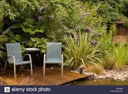 garden seating. Garden Seating On Wooden Decking, Overlooking Wildlife Pond, England, UK