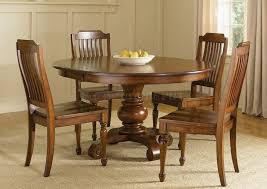 solid wood round dining room table and chairs