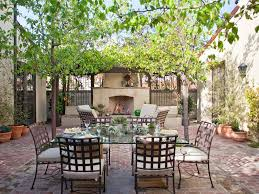 Dining Room:Charming Mediterranean Dining Area Using Traditional Outdoor  Fireplace Plus Rectangle Glass Coffee Table
