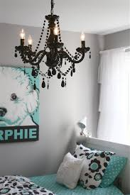 cute girl bedroom decoration using black crystal girl room chandelier including light grey girl room wall paint and turquoise door painting