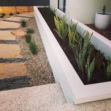 rendered brick raised garden beds with