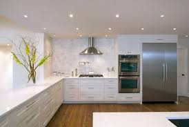 portland carrera marble tile backsplash with contemporary ovens kitchen transitional and white countertop