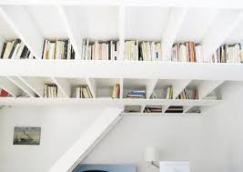 When your footprint is limited, consider going vertical and storing your  books in your rafters. This storage solution draws the eye up and provides  ...