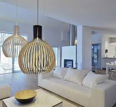 large room lighting. three hanging pendant lights pick up the color of countertops in a kitchen contemporary large room lighting c