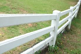 white fence on hill