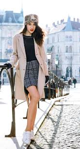 fashion blogger veronika lipar of brunette from wall street wearing white sneakers from sel off