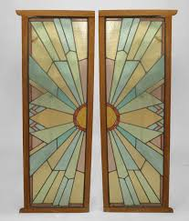 pair of wood framed leaded glass french doors that each represent half of a geometric