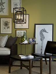 space living room olive: love the prints and the green wall color