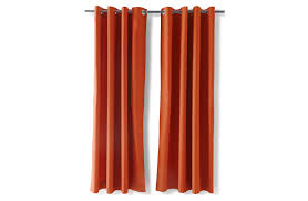 a pair of orange curtains made of cotton