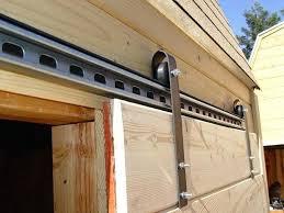 making a sliding barn door using skateboard wheels diy