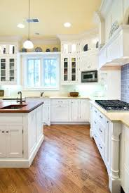 kitchen floors with white cabinets floor kitchen cabinets design white cabinets wood floor antique white kitchen