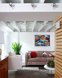 corrugated metal ceiling basement basement modern with white armchair grey rug white armchair