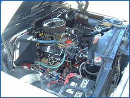 chevrolet c pickup mechanical section page  photo m 24 b shows the passenger side view of the 350 c i d v8 engine in