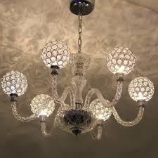 the led chandelier has an authentic look desired by many the chic and elegant 6 arm crystal chandelier has 6 bulb holders which sit in a light reflecting