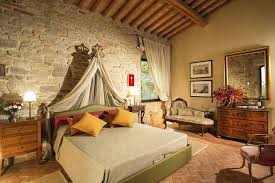 Tuscan Bedrooms With Stone Walls And Curtains And Sofa