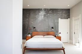 gray bedroom with mural of california redwoods and natural wood furniture