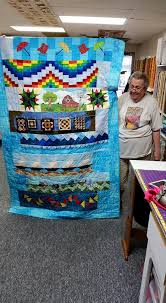 Quilts by The Oz - Home | Facebook & Image may contain: 1 person, standing Adamdwight.com