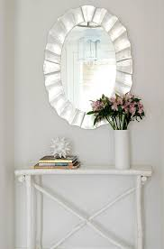 mirror and table for foyer. White And Silver Foyer Boasts A Rippled Oval Mirror, Made Goods Lara Mirror Table For T