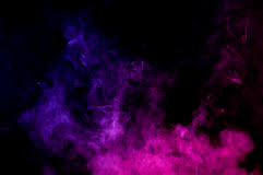 Abstract Smoke In Blue And Pink Isolated On Black Stock Photo