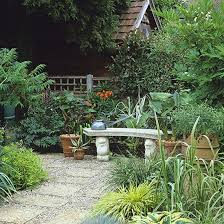 Courtyard Design Ideas An Inviting Stone Bench In A Small Courtyard Of Paving Slabs On Gravel Edged In