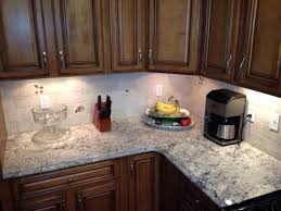 White Ice Granite Kitchen White Ice Granite Countertop And Cabinets Dark Hardwood Flooring