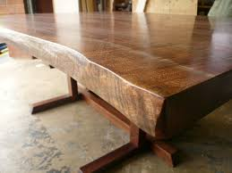 popular brown teak japanese dining table with neutral polished on concrete floors as inspiring rustic dining table ideas