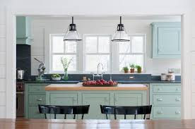 light blue kitchen cabinets with dark gray counters