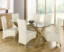 glass dining table. Adorable Rectangle All Glass Dining Table Design With White Chairs Slipcover And Wooden Floor Large L