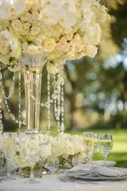 hanging crystals for wedding centerpieces. white and ivory centerpiece with hanging crystals for wedding centerpieces