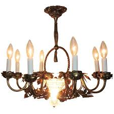 wonderful french roses decorate bronze chandelier with both the candle cups and entwine around the eight